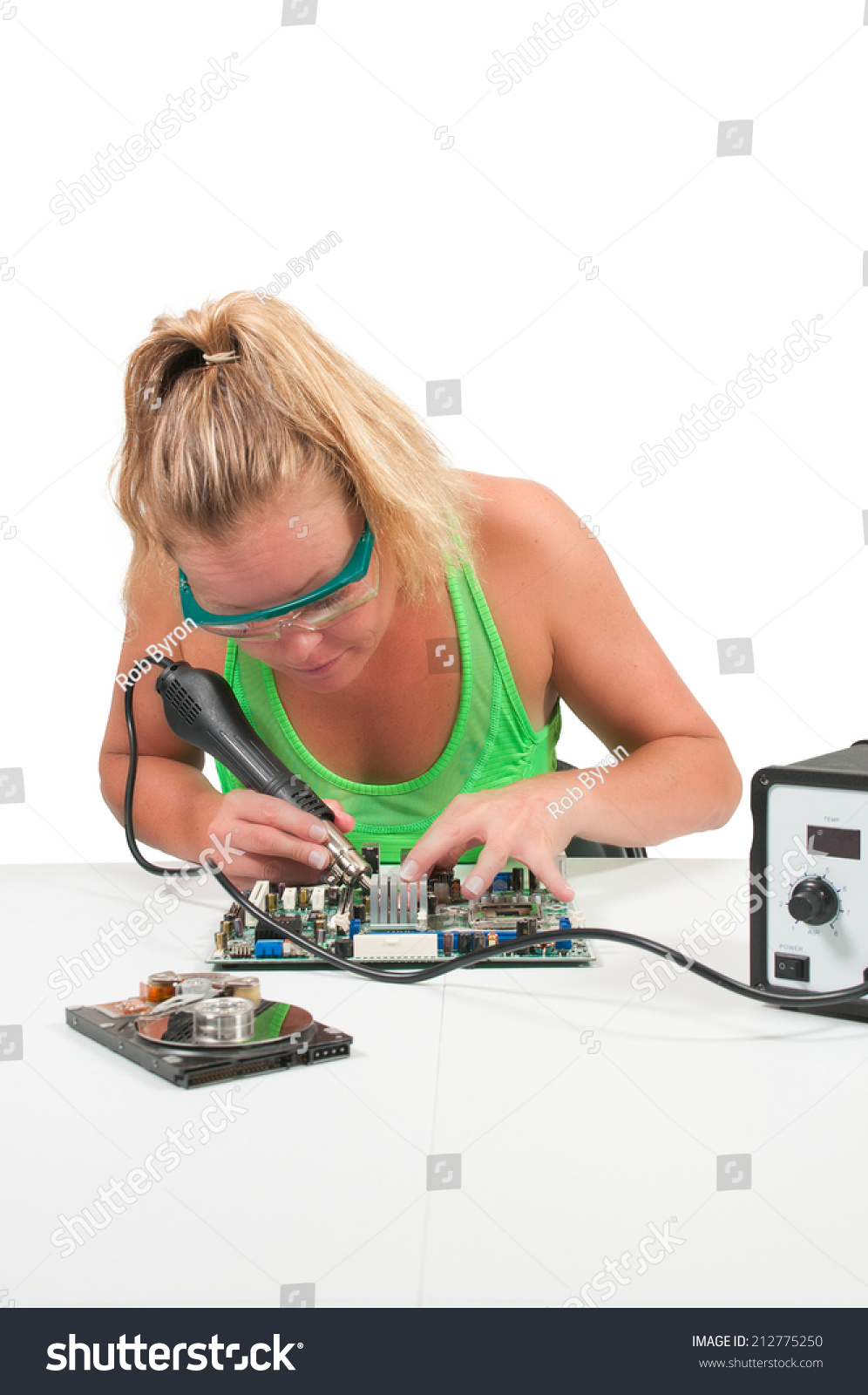 http://image.shutterstock.com/z/stock-photo-beautiful-woman-repairing-a-printed-circuit-board-with-a-forced-air-soldering-iron-212775250.jpg