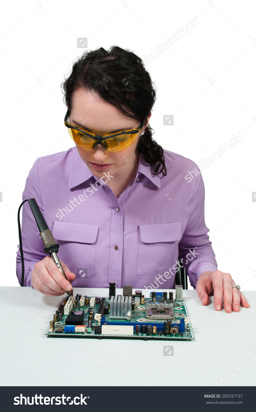http://image.shutterstock.com/z/stock-photo-beautiful-woman-repair-soldering-a-printed-circuit-board-205937137.jpg